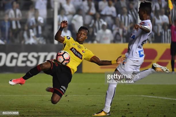 Bruno Henrique of Brazils Santos vies for the ball with goalkeeper Dario Aimar of Ecuador's Barcelona during their 2017 Copa Libertadores...