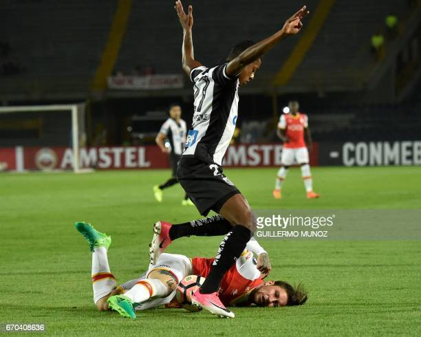 Bruno Henrique of Brazil´s Santos vies for the ball with Jonatan David Gomez of Colombia's Santa Fe during their Libertadores Cup football match at...
