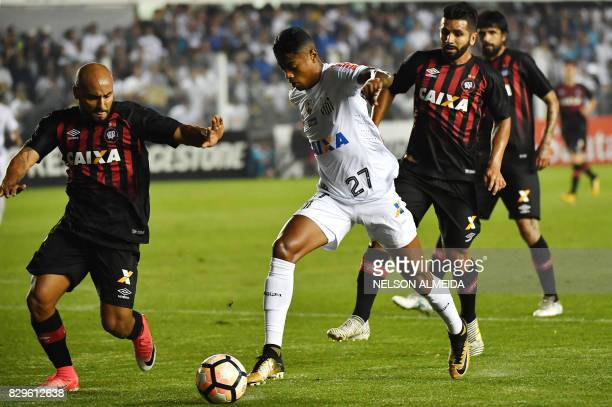 Bruno Henrique of Brazils Santos vies for the ball with Jonathan of Brazil's Atletico Paranaense during their 2017 Copa Libertadores football match...