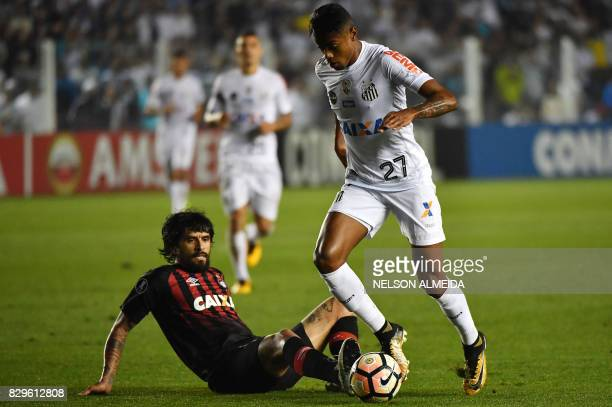 Bruno Henrique of Brazils Santos vies for the ball with Lucho Gonzalez of Brazil's Atletico Paranaense during their 2017 Copa Libertadores football...