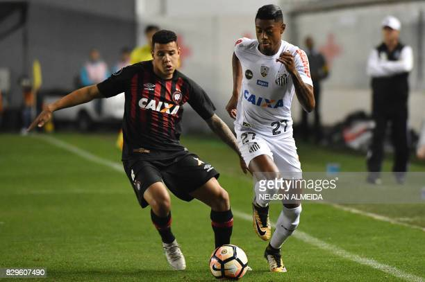 Bruno Henrique of Brazil's Santos vies for the ball with Sidcley of Brazil's Atletico Paranaense during their 2017 Copa Libertadores football match...