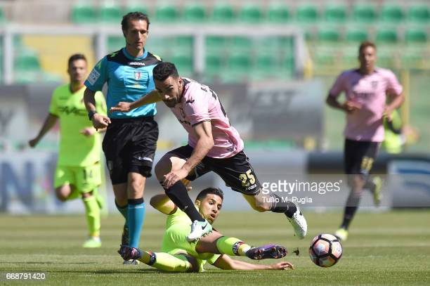 Bruno Henrique of Palermo is challenged by Saphir Taider of Bologna during the Serie A match between US Citta di Palermo and Bologna FC at Stadio...