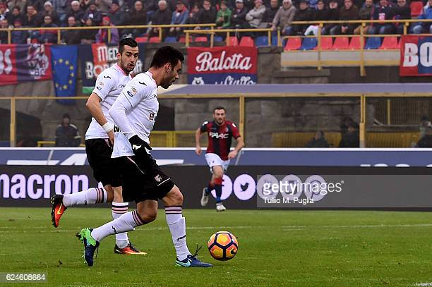 Bruno Henrique of Palermo passes the ball to Ilija Nestorovski who will score the opening goal during the Serie A match between Bologna FC and US...
