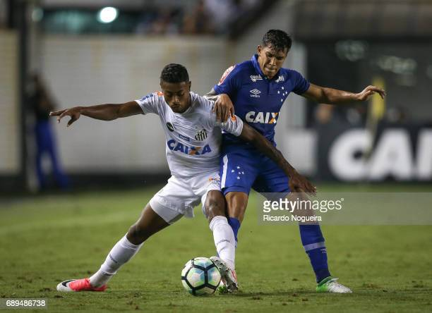 Bruno Henrique of Santos battles for the ball with Lucas Romero during the match between Santos and Cruzeiro as a part of Campeonato Brasileiro 2017...