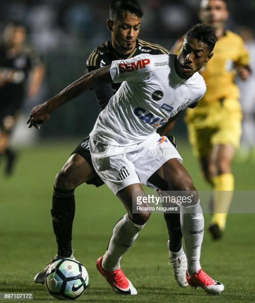 Bruno Henrique of Santos battles for the ball with Lucca during the match between Santos and Ponte Preta as a part of Campeonato Brasileiro 2017 at...