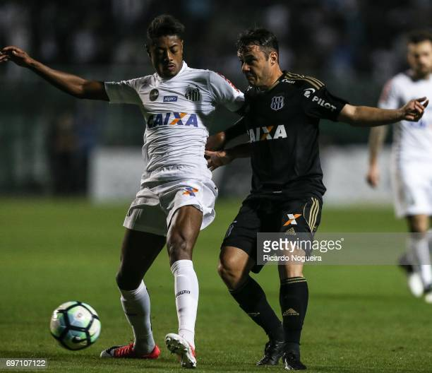 Bruno Henrique of Santos battles for the ball with Renato Caja of Ponte Preta during the match between Santos and Ponte Preta as a part of Campeonato...