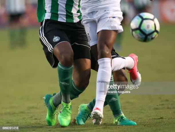 Bruno Henrique of Santos battles for the ball with Wallisson Maia and Werley during a match between Santos and Coritiba as a part of Campeonato...