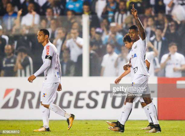 Bruno Henrique of Santos celebrates their first goal with his team mates during the match between Santos and Atletico PR for the Copa Bridgestone...