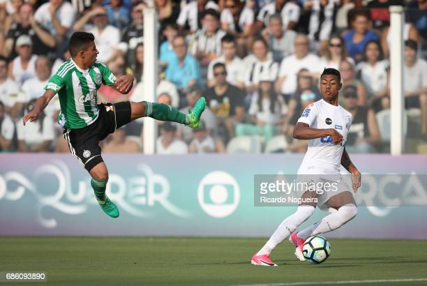 Bruno Henrique of Santos competes for the ball with William Matheus during a match between Santos and Coritiba as a part of Campeonato Brasileiro...