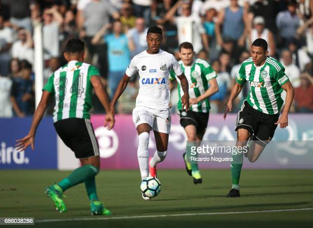Bruno Henrique of Santos is closed down by Werley and Wallisson Maia of Coritiba during a match between Santos and Coritiba as a part of Campeonato...