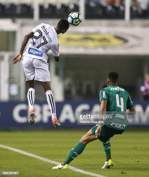 Bruno Henrique of Santos wins a header with Juninho of Palmeiras during a match between Santos and Palmeiras as a part of Campeonato Brasileiro 2017...