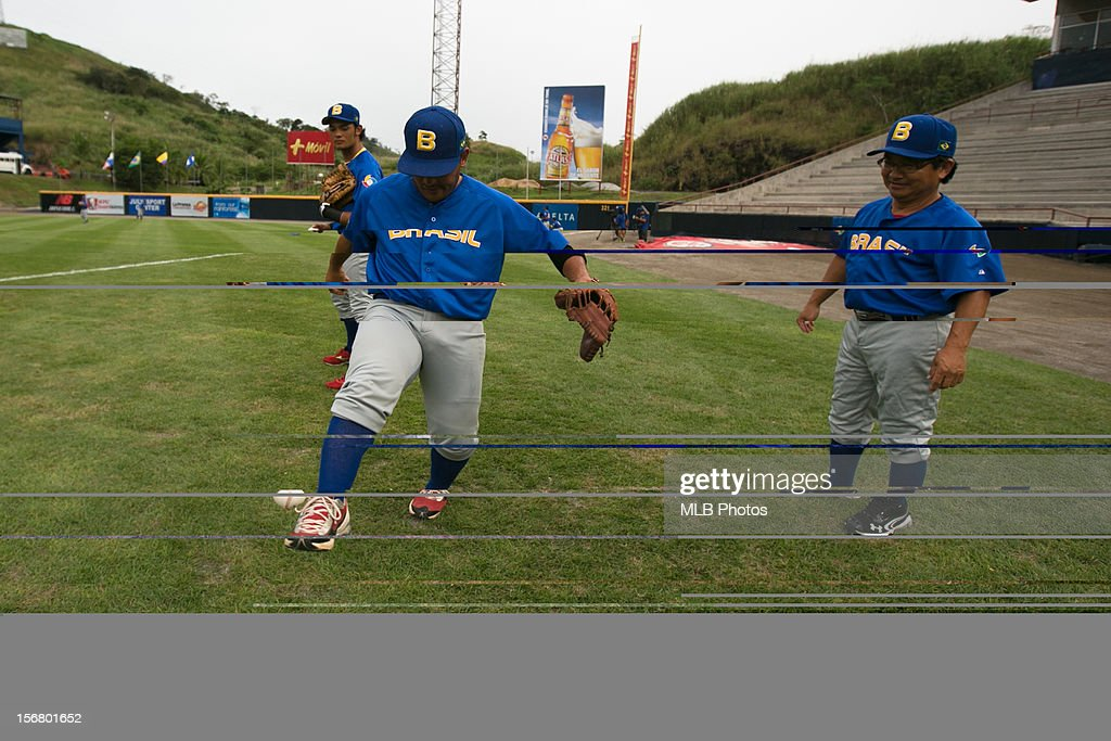 Bruno Hirata #26 of Team Brazil juggles a baseball with his feet before Game 6 of the Qualifying Round of the World Baseball Classic against Team Panama at Rod Carew National Stadium on Monday, November 19, 2012 in Panama City, Panama.
