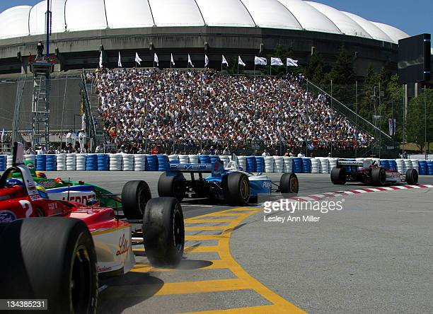 Bruno Junqueira led the field through Turn 1 during 2003 Molson Indy Vancouver at Concord Pacific Place in Vancouver Canada