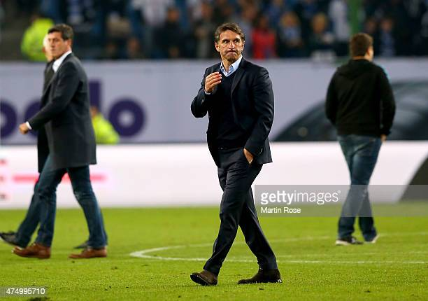 Bruno Labbadia head coach of Hamburg reacts after the Bundesliga first leg play off match between Hamburger SV and Karlsruher SC at Imtech Arena on...