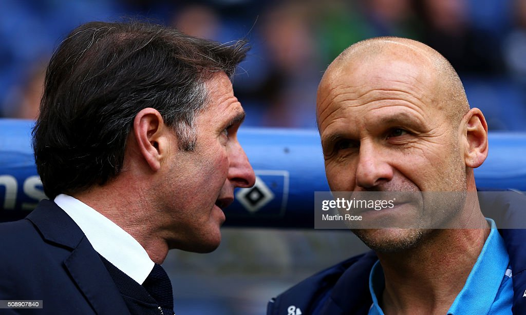 Bruno Labbadia (L), head coach of Hamburg talks to assistnt coach Bernhard Tares before the Bundesliga match between Hamburger SV and 1. FC Koeln at Volksparkstadion on February 7, 2016 in Hamburg, Germany.