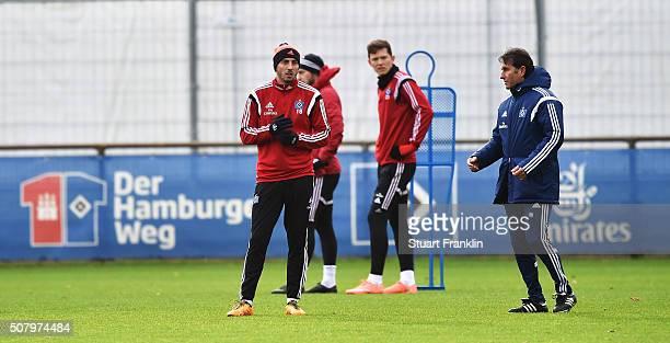 Bruno Labbadia head coach of Hamburg talks with Josip Drmic during a training session of Hamburger SV on February 2 2016 in Hamburg Germany