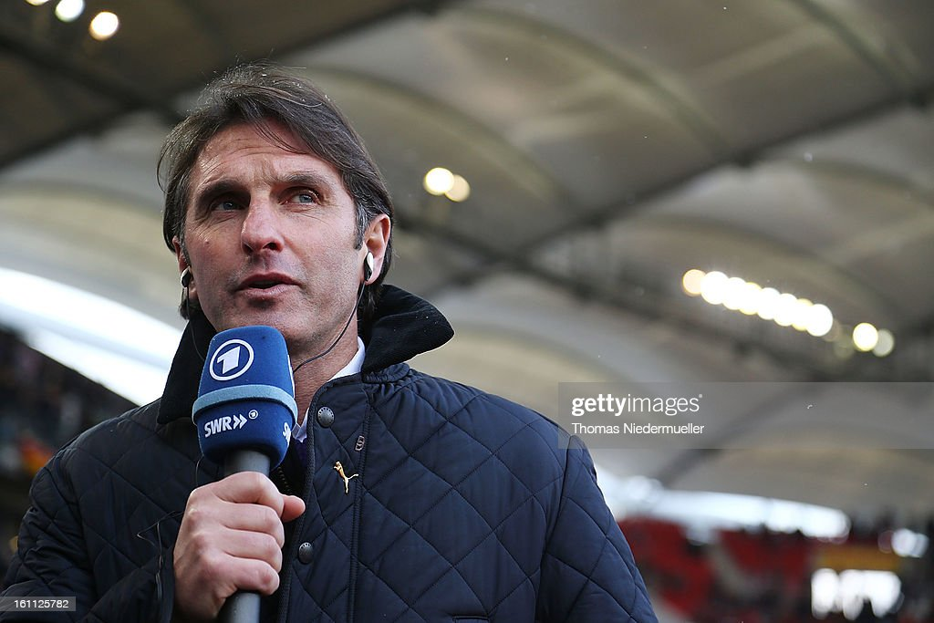 Bruno Labbadia, head coach of Stuttgart, speaks into a microphone prior to the Bundesliga match between VfB Stuttgart and Werder Bremen at Mercedes-Benz Arena on February 9, 2013 in Stuttgart, Germany.