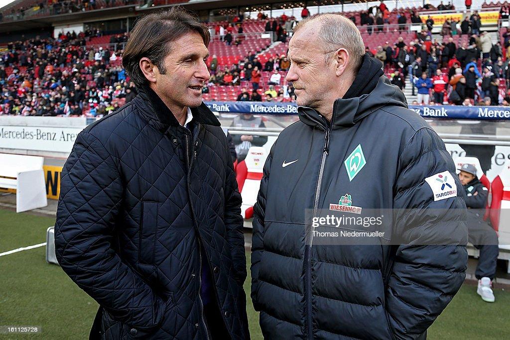 Bruno Labbadia (L), head coach of Stuttgart talks to Thomas Schaaf (R), head coach of Bremen prior to the Bundesliga match between VfB Stuttgart and Werder Bremen at Mercedes-Benz Arena on February 9, 2013 in Stuttgart, Germany.