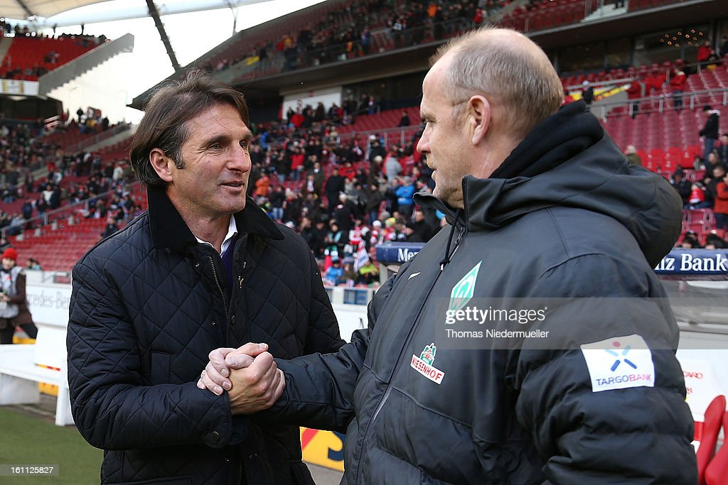 Bruno Labbadia (L), head coach of Stuttgart talks to Thomas Schaaf (R), head coach of Bremen prior to the Bundesliga match between VfB Stuttgart and Werder Bremen at Mercedes-Benz Arena on February 9, 2013 in Stuttgart, Germany.