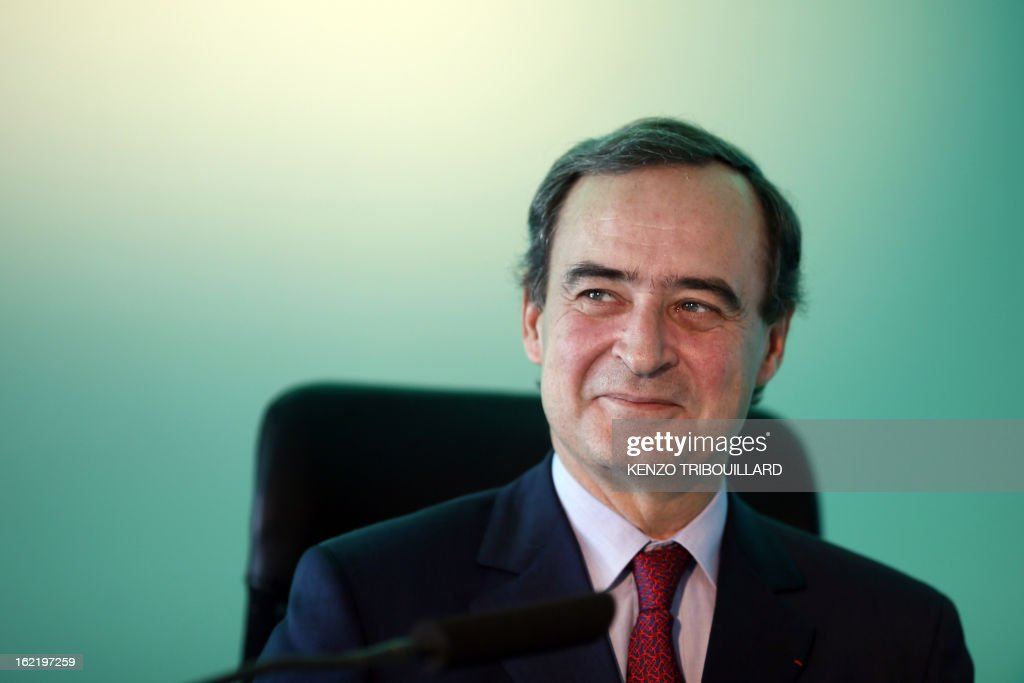 Bruno Lafont, Chief Executive of France's Lafarge, the world's biggest cement maker, smiles before presenting the group's 2012 results in Paris during a press conference on February 20, 2013.