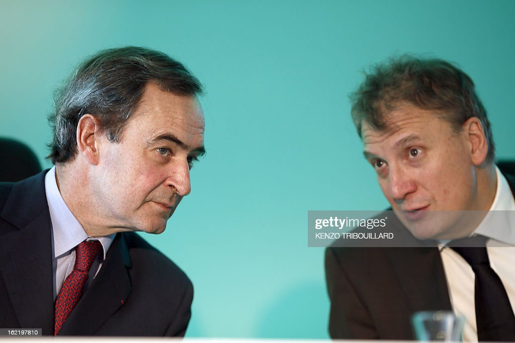 Bruno Lafont (L), Chief Executive of France's Lafarge, the world's biggest cement maker, speaks with Jean-Jacques Gauthier, general director of French constructions group Lafarge, during the presentation of the group's 2012 results in Paris during a press conference on February 20, 2013.