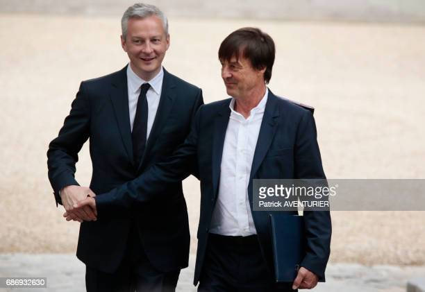Bruno Le Maire and Nicolas Hulot arrive for a cabinet meeting at the Elysée Palace in Paris France on Thursday May 18 2017