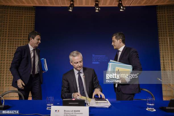 Bruno Le Maire France's finance minister center prepares to depart as Benjamin Griveaux France's junior economy minister left and Gerald Darmanin...