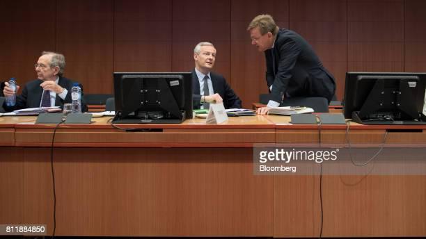 Bruno Le Maire France's finance minister center speaks with Johan Van Overtveldt Belgium's finance minister right as Pier Carlo Padoan Italy's...