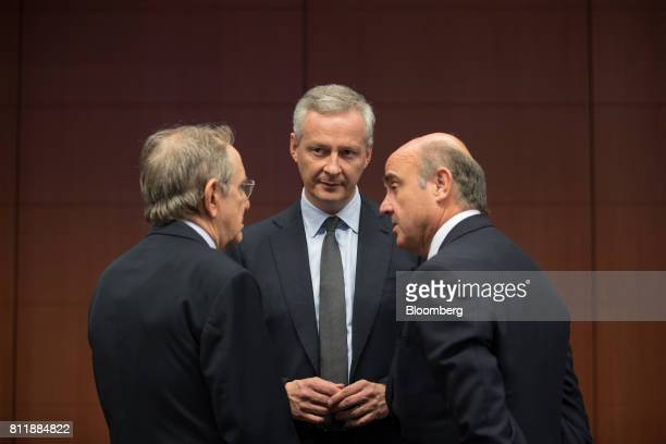Bruno Le Maire France's finance minister center speaks with Pier Carlo Padoan Italy's finance minister left and Luis de Guindos Spain's finance...