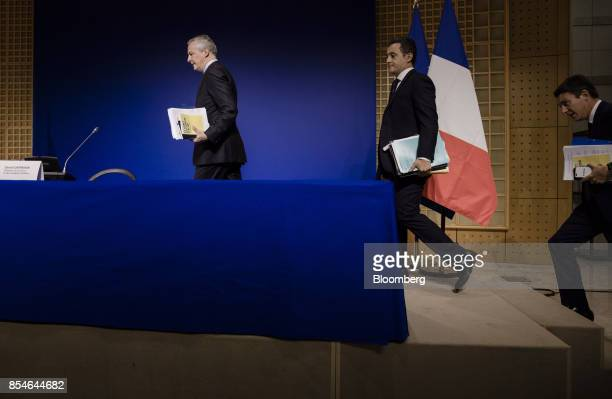 Bruno Le Maire France's finance minister left arrives with Gerald Darmanin France's minister of public action and accounts center and Benjamin...