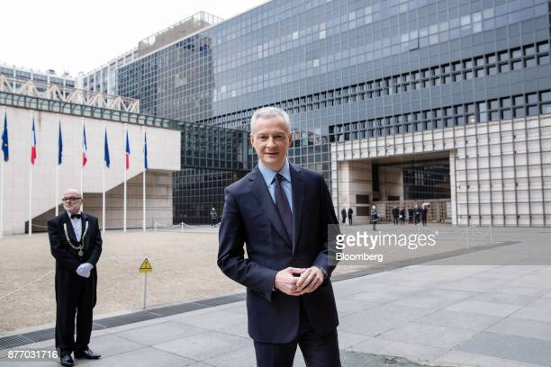 Bruno Le Maire France's finance minister poses for a photograph as he awaits the arrival of France's President Emmanuel Macron outside the French...