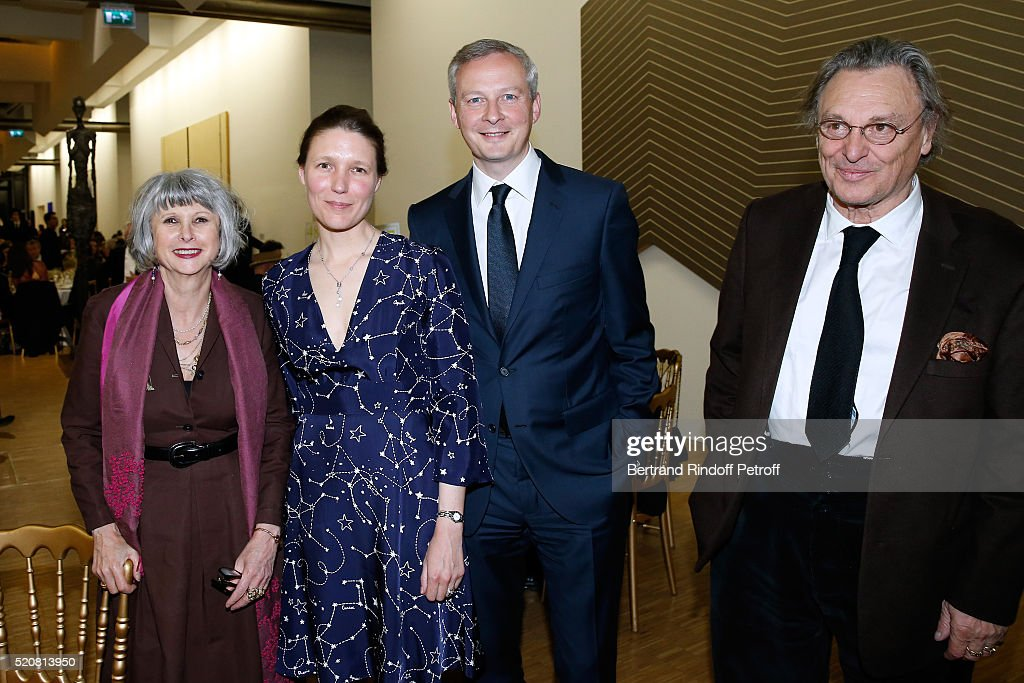 Bruno Lemaire with his wife and Gerard Garouste with his wife attend the Societe des Amis du Musee d'Art Moderne du Centre Pompidou : Dinner Party. Held at Centre Pompidou on April 12, 2016 in Paris, France.