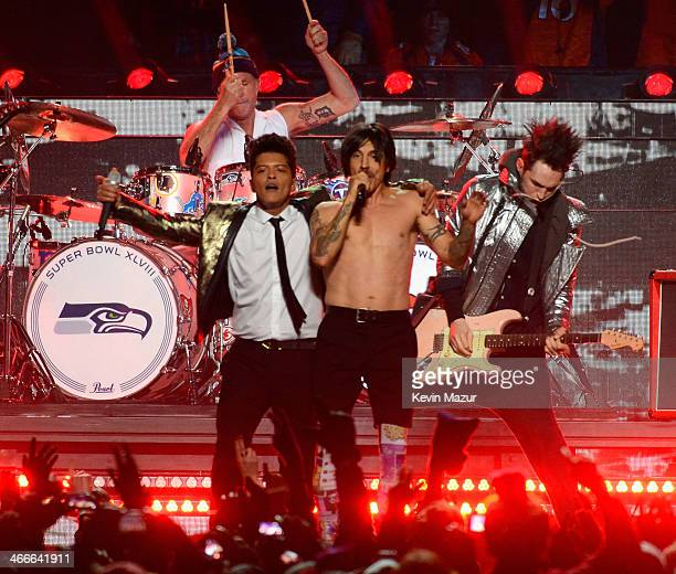 Bruno Mars and Anthony Kiedis of the Red Hot Chili Peppers perform during the Pepsi Super Bowl XLVIII Halftime Show at MetLife Stadium on February 2...