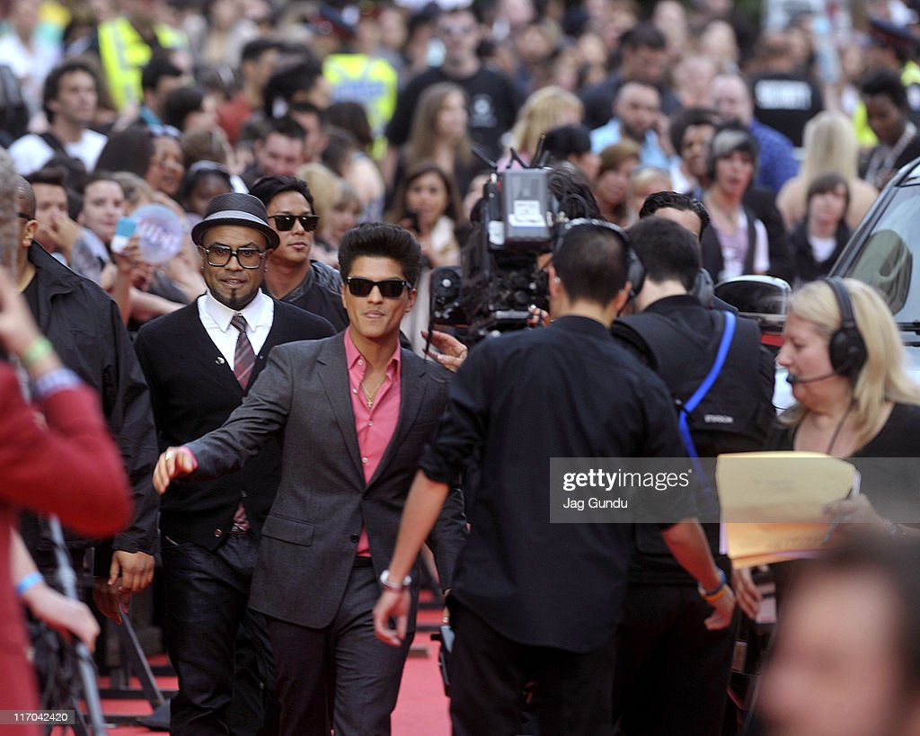 <a gi-track='captionPersonalityLinkClicked' href=/galleries/search?phrase=Bruno+Mars&family=editorial&specificpeople=6779692 ng-click='$event.stopPropagation()'>Bruno Mars</a> arrives on the red carpet at the 22nd Annual MuchMusic Video Awards at the MuchMusic HQ on June 19, 2011 in Toronto, Canada.