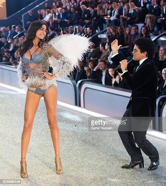 Bruno Mars performs as Kelly Gale walks the catwalk during the annual Victoria's Secret fashion show at Grand Palais on November 30 2016 in Paris...
