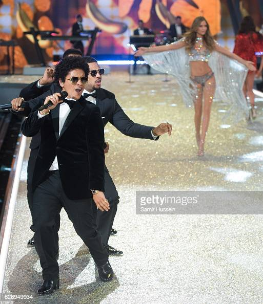 Bruno Mars performs as models walk the catwalk during the annual Victoria's Secret fashion show at Grand Palais on November 30 2016 in Paris France