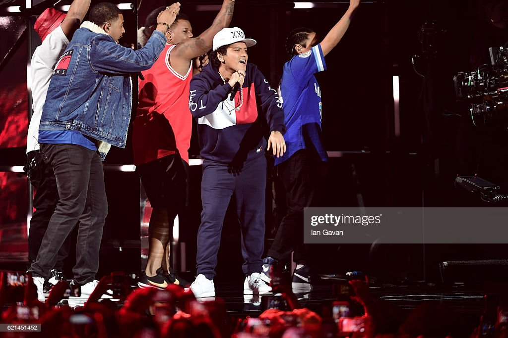bruno-mars-performs-on-stage-at-the-mtv-europe-music-awards-2016-on-picture-id621451452