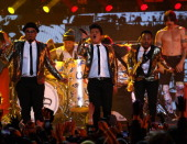 Bruno Mars performs with the Red Hot Chili Peppers during the Pepsi Super Bowl XLVIII Halftime Show at MetLife Stadium on February 2 2014 in East...