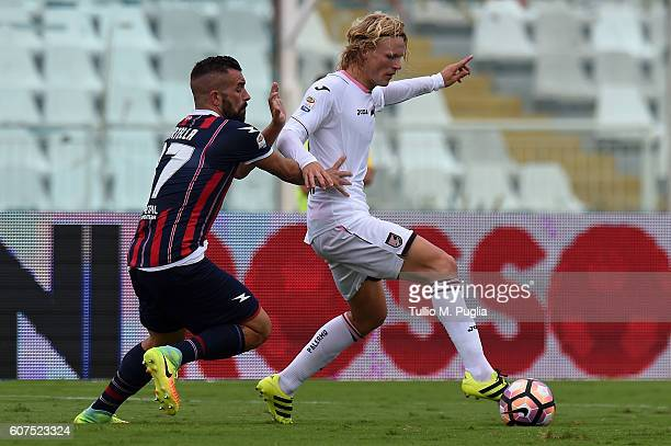 Bruno Martella of Crotone and Oscar Hiljemark of Palermo compete for the ball during the Serie A match between FC Crotone and US Citta di Palermo at...