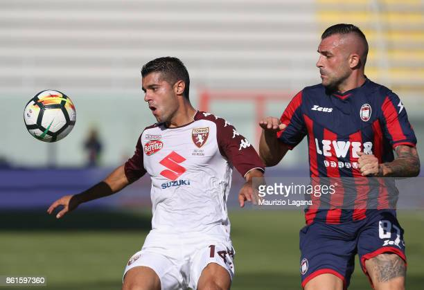 Bruno Martella of Crotone competes for the ball with Iago Falque of Torino during the Serie A match between FC Crotone and Torino FC at Stadio...