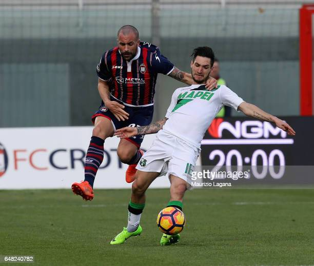 Bruno Martella of Crotone competes for the ball with Matteo Politano of Sassuolo during the Serie A match between FC Crotone and US Sassuolo at...