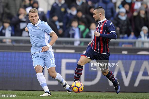 Bruno Martella of FC Crotone compete for the ball with Ciro Immobile of SS Lazio during the Serie A match between SS Lazio and FC Crotone at Stadio...