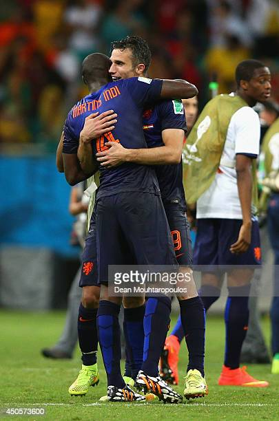 Bruno Martins Indi and Robin van Persie of the Netherlands celebrate victory after the 2014 FIFA World Cup Brazil Group B match between Spain and...