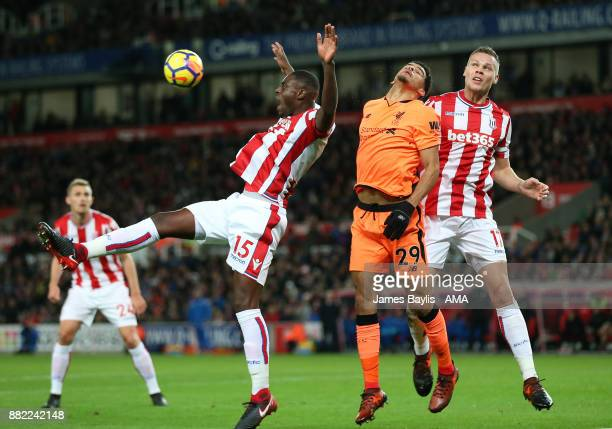 Bruno Martins Indi and Ryan Shawcross of Stoke City and Dominic Solanke of Liverpoolduring the Premier League match between Stoke City and Liverpool...