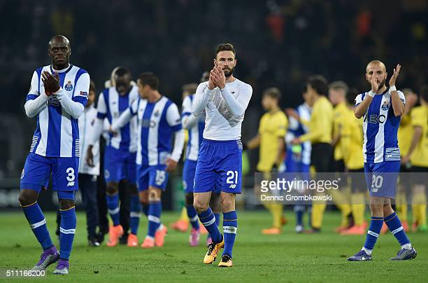 Bruno Martins Indi Miguel Layun and Andre Andre of FC Porto applaud away supporters after their 02 defeat in the UEFA Europa League round of 32 first...