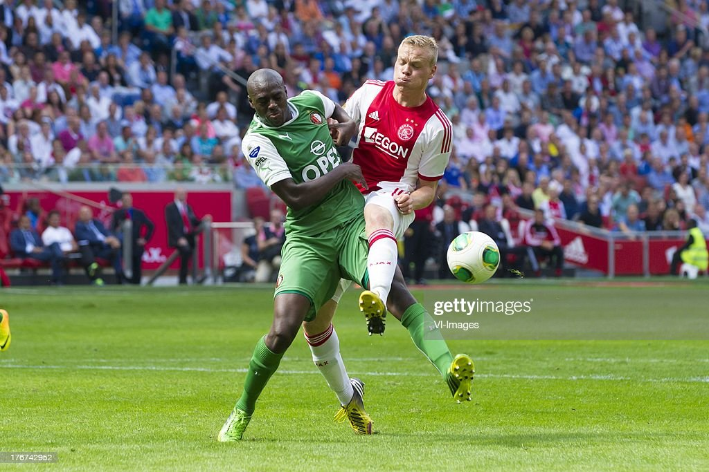Bruno Martins Indi of Feyenoord, Kolbeinn Sigthorsson of Ajax during the Dutch Eredivisie match between Ajax Amsterdam and Feyenoord on August 18, 2013 at the Amsterdam Arena in Amsterdam, The Netherlands.