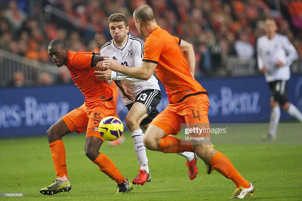 Bruno Martins Indi of Holland, Thomas Muller of Germany, Ron Vlaar of Holland during the Friendly match between Holland and Germany at the Amsterdam Arena on November 14, 2012 in Amsterdam, The Netherlands.
