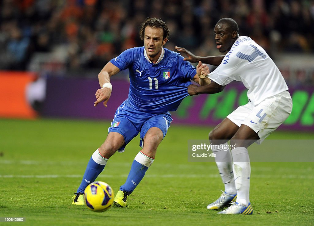 Bruno Martins Indi (R) of Netherlands and <a gi-track='captionPersonalityLinkClicked' href=/galleries/search?phrase=Alberto+Gilardino&family=editorial&specificpeople=215491 ng-click='$event.stopPropagation()'>Alberto Gilardino</a> of Italy (L) compete for the ball during the international friendly match between Netherlands and Italy at Amsterdam Arena on February 6, 2013 in Amsterdam, Netherlands.