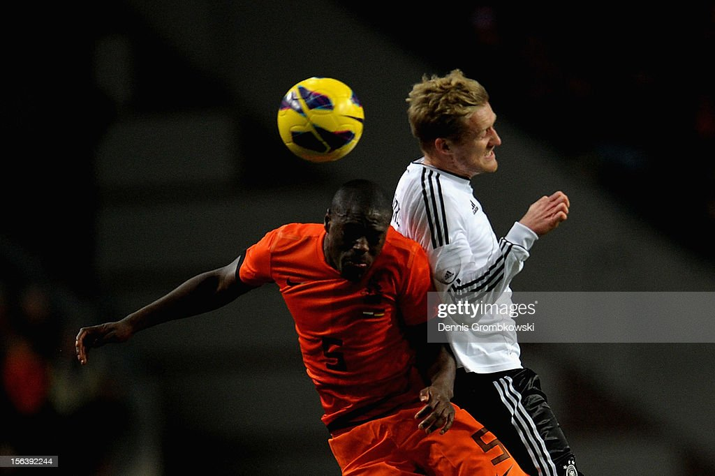 Bruno Martins Indi of Netherlands and <a gi-track='captionPersonalityLinkClicked' href=/galleries/search?phrase=Andre+Schuerrle&family=editorial&specificpeople=5513825 ng-click='$event.stopPropagation()'>Andre Schuerrle</a> of Germany go up for a header during the International Friendly match between Netherlands and Germany at Amsterdam Arena on November 14, 2012 in Amsterdam, Netherlands.