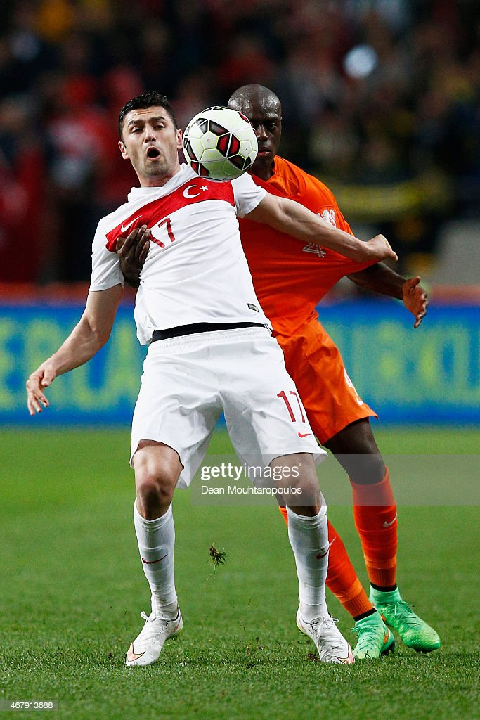 <a gi-track='captionPersonalityLinkClicked' href=/galleries/search?phrase=Bruno+Martins+Indi&family=editorial&specificpeople=7155940 ng-click='$event.stopPropagation()'>Bruno Martins Indi</a> of Netherlands and <a gi-track='captionPersonalityLinkClicked' href=/galleries/search?phrase=Burak+Yilmaz&family=editorial&specificpeople=8254293 ng-click='$event.stopPropagation()'>Burak Yilmaz</a> of Turkey batle for the ball during the UEFA EURO 2016 qualifier match bewteen the Netherlands and Turkey held at Amsterdam Arena on March 28, 2015 in Amsterdam, Netherlands.